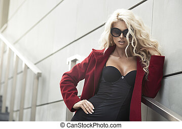Sexy woman with sunglasses in city
