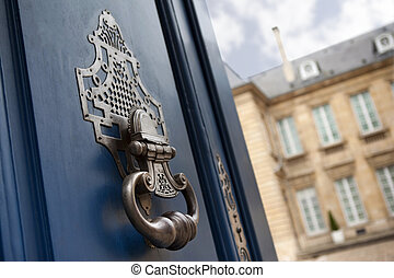 Knocker - Door and knocker of a French mansion
