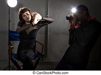 Paparazzi - photographer taking an actress photo with flash...