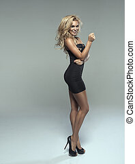 Fashionable young sensual woman - Fashionable young blonde...