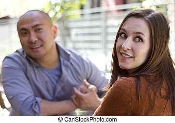 Incompatible Date - bored incompatible couple on an outdoor...