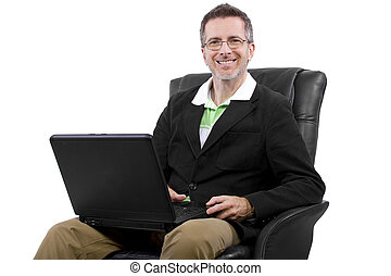 Self Employed Man - adult male working from home in a...