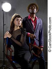 Pompous Actors - stylish actors posing on a concrete...