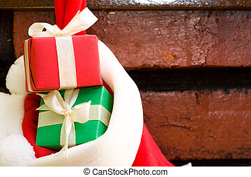 Gift boxes in a Christmas sock - Gift boxes with ribbon in a...
