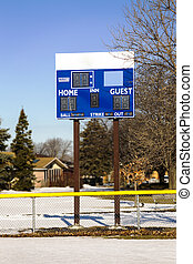 Waiting for Summer - Scoreboard in a softball field amidst...