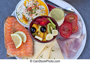 Brunch - Salmon, ham, cheese and fruit salad for a brunch