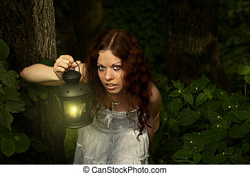 In true search - The girl with a lantern restlessly looks on...