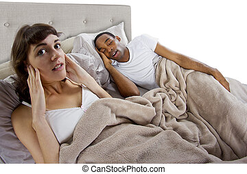 Snoring Partner - unable to sleep in bed because of snoring...