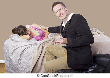Waking Up Daughter - father waking up young girl in the...
