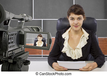 Filming Female Reporter - camera view of a female reporter...