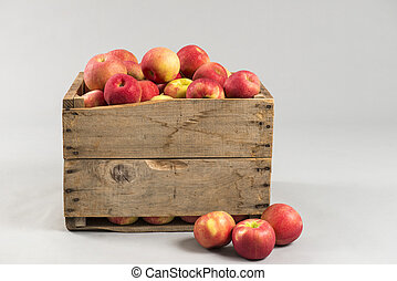 woodern crate full of apples