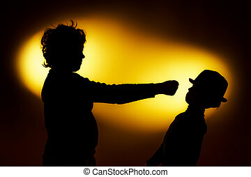 Two expressive boys silhouettes showing emotions using...