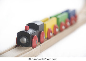 Wooden toy train setup - different colored cars