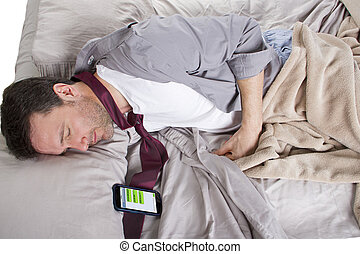 Oversleeping Employee - male sleeping in work clothes and...