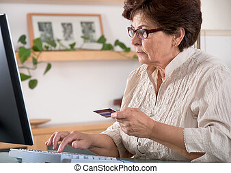 online shopping - Senior woman on computer. Concept may be...