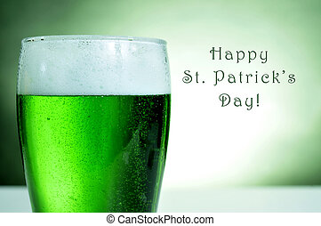 happy saint patricks day - a glass with dyed green beer and...