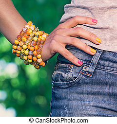 Colorful bracelet on a womans hand - Woman wearing a...
