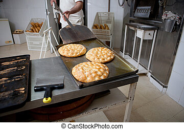Making olive oil pancakes - Elaboration process of...