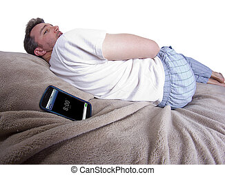 Snoozing Alarm Clock - man snoozing modern cell phone alarm...