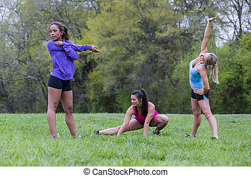 3 Girls Enjoying The Park - Three young women enjoying a day...