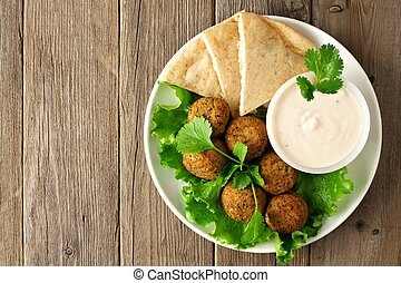 Falafel with pita and tzatziki - Plate of falafel with pita...