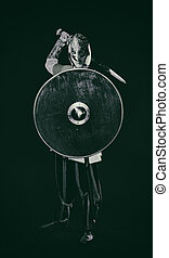 Medieval knight armor with a sword, helmet and shield, black...