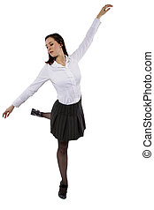 Balancing - female student or businesswoman balancing on one...