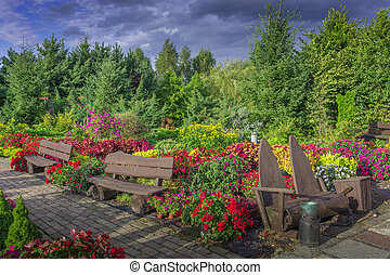 Colorful garden - Spring green garden bathed in colorful...