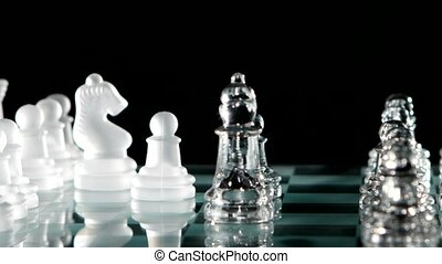 Fight chess pieces on chesboard Black background