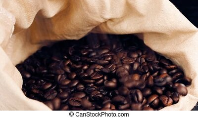 coffee beans falling down - a lot of coffee beans falling...