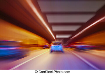 cars go in lit tunnel - cars quickly go in lit tunnel
