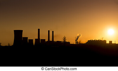 Sunset over the over the silhouette factory. ArcelorMittal...