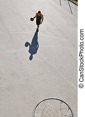 street basketball - gorup of young boys who playing...