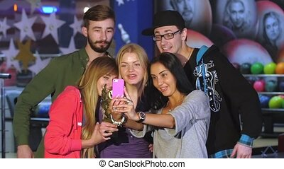 Selfie Smiles and hugs with the victory in a game of bowling...