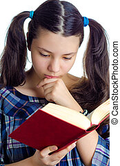 Girl Reading a Book - Female child reading a book against a...