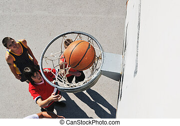 street basketball - group of young boys who playing...