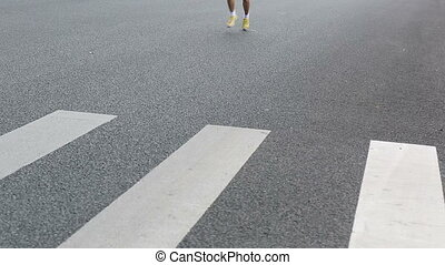 marathon runners on the street at Xiamen International...