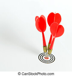 Consistency - Three red darts pinned right on the center of...