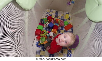 Child in children arena - Sitting in playpen child play toy