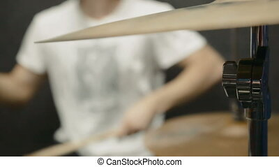 Drums Player - Drummer preforming on a drum set