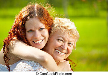 Family - Embraces happy mothers with the adult daughter...