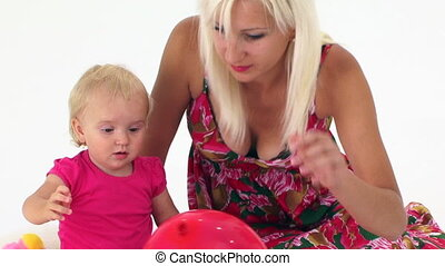 Mother And Her Baby Playing With Balloon