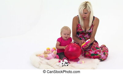 Mother And Her Baby Playing With Toys - Mother with her cute...