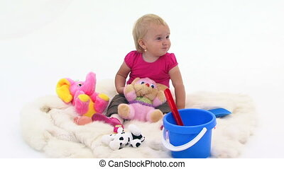 Baby Girl With Toys On White Cover - Baby girl in pink...