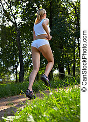 Running - Morning jog of the woman in park