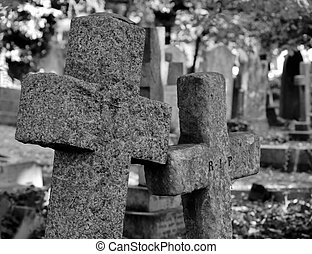 2 stone cross tombstones