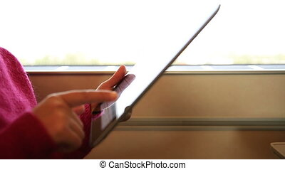 woman use  digital tablet on train
