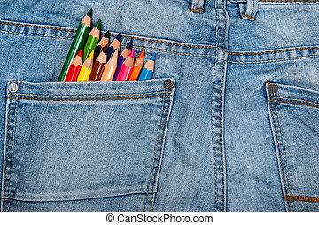 Multicolored pencils in pocket