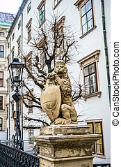 Lion statue near Hofburg Royal Palace in Vienna, Austria