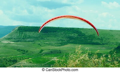 Paraglider Soaring In the Sky - Multi frame tracking shot of...